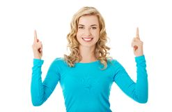 Woman pointing on copy space. Stock Photos