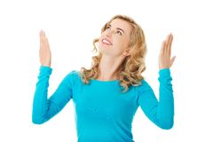 Woman pointing on copy space. Stock Image