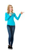 Woman pointing on copy space. Stock Photo