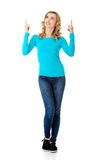 Woman pointing on copy space. Royalty Free Stock Photography
