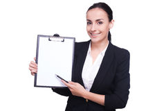 Woman pointing copy space. Stock Images