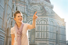 Woman pointing on copy space in florence, italy Stock Images