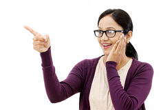 Woman pointing at copy space with index finger Stock Photography