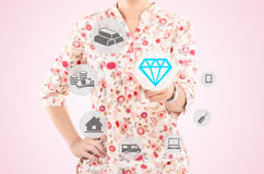 Woman pointing a diamond in the concept of lifestyle Royalty Free Stock Photos
