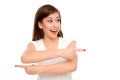 Woman pointing in different directions Royalty Free Stock Photos
