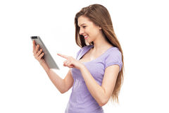 Woman pointing at digital tablet Royalty Free Stock Photo
