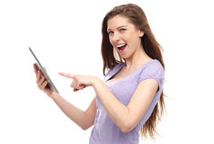 Woman pointing at digital tablet Stock Image