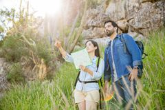 Woman pointing directions to her boyfriend Royalty Free Stock Photo
