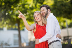 Woman pointing at a distance Royalty Free Stock Image