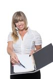 Woman is pointing at a document with a pen Stock Images