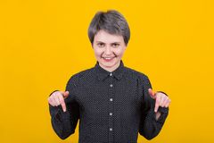 Woman pointing down stock images