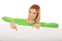 Woman pointing on empty banner. Stock Photos