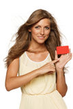 Woman pointing at empty business carf Royalty Free Stock Photos
