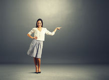 Woman pointing at empty copyspace Stock Images