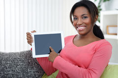 Woman pointing at empty  tablet screen Royalty Free Stock Photography