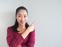 Woman pointing on empty wall. Royalty Free Stock Images