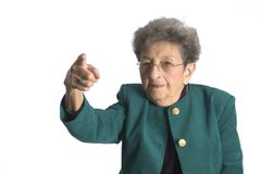 Woman pointing finger. Serious senior woman pointing fnger at you royalty free stock photography