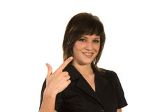 Woman pointing a finger. Smiling woman pointing a finger at herself on a white background Royalty Free Stock Image