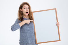 Woman pointing finger on blank board Royalty Free Stock Photography