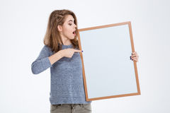 Woman pointing finger on blank board Stock Photos