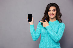 Woman pointing finger on blank smartphone screen Stock Photo