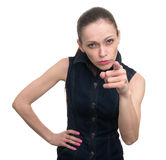 Woman pointing finger at camera. Isolated Royalty Free Stock Photography