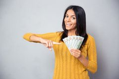 Woman pointing finger on dollar bills Royalty Free Stock Photo
