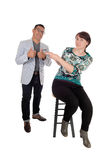 Woman pointing finger at her husband. Royalty Free Stock Photography