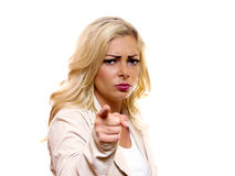 Woman pointing finger. Image of a serious looking woman pointing her finger royalty free stock images