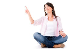 Woman pointing with finger Royalty Free Stock Images