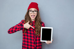 Woman pointing finger on tablet computer screen Royalty Free Stock Photos