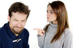 Woman pointing finger to desperate sad husband Royalty Free Stock Photography