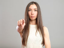 Woman pointing finger to viewer Royalty Free Stock Photos