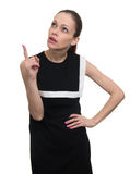Woman pointing finger up at copyspace. isolated Royalty Free Stock Photo