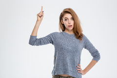 Woman pointing finger up Stock Photo