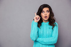 Woman pointing finger up Stock Images