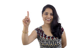 Woman pointing finger up showing ONE or WAIT A MINUTE. Royalty Free Stock Photography