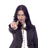 Woman pointing finger at viewer. Beautiful young woman, determent gesture Royalty Free Stock Photo