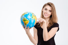 Woman pointing finger on world globe Stock Photos