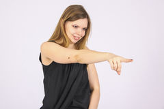 Woman pointing with finger Stock Images