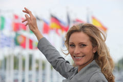 Woman pointing at flags Royalty Free Stock Photo