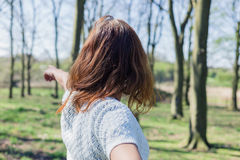 Woman pointing in forest Royalty Free Stock Photo