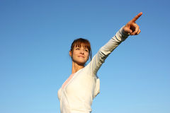 A woman pointing forward Royalty Free Stock Images