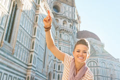 Woman pointing in front of cattedrale in florence Royalty Free Stock Photography