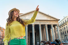 Woman pointing in front of pantheon in rome, italy Stock Photo