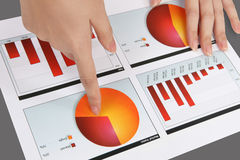 Woman Pointing at Graph. A woman pointing at a colorful chart graph Stock Photos