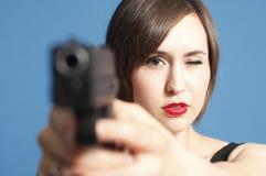 Woman pointing gun Stock Image