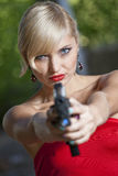 Woman pointing gun Stock Image