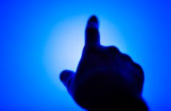 Woman pointing hand. Woman pointing or pressing hand. Silhouette on blue monitor background Royalty Free Stock Photos