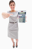 Woman pointing at hand calculator Stock Photography